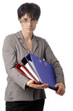Mature business woman looking over her glasses Stock Image