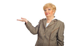 Mature business woman make presentation to copy Stock Photography