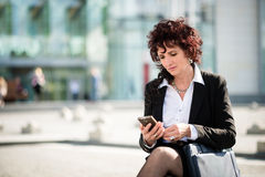 Mature business woman with phone in street Stock Photography