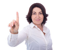 Mature business woman pointing at something isolated on white. Background Stock Photos