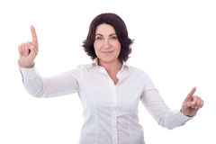 Mature business woman pressing imaginary buttons isolated on whi. Te background Royalty Free Stock Photo