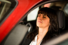 Mature business woman resting in car Stock Images