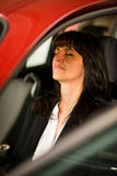 Mature business woman resting in car Stock Image