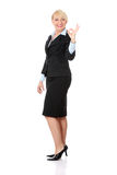 Mature business woman's gesticulating perfect. Stock Photo