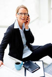 Mature business woman sitting Royalty Free Stock Photography
