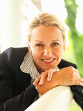 Mature business woman smiling confidently Stock Images
