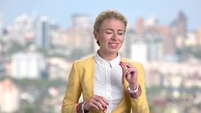 Mature business woman in suit enjoying music. stock video