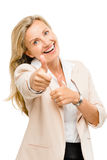Mature business woman thumbs up smiling isolated on white backgr Royalty Free Stock Photography
