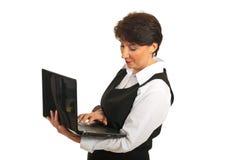 Mature business woman using laptop Stock Photo