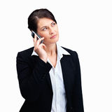 Mature business woman using mobile phone on white Stock Images