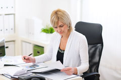 Mature business woman working at office stock photo