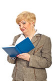 Mature business woman writing in agenda Royalty Free Stock Images