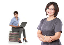 mature business women standing with her secretary behind holding Stock Photo