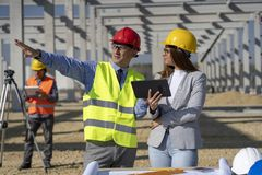 Free Mature Businessman And Young Female Architect Meeting At Construction Site Royalty Free Stock Photography - 162174467