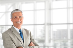 Mature Businessman Arms Crossed Royalty Free Stock Image