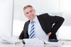 Mature businessman with back pain Royalty Free Stock Photo