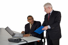 Mature businessman being instructed by his boss Royalty Free Stock Photo