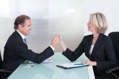 Mature Businessman And Businesswoman Holding Hand Royalty Free Stock Image