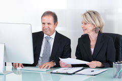 Mature Businessman And Businesswoman At Work Stock Image