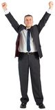 Mature businessman cheering with arms up. On white background Royalty Free Stock Photography