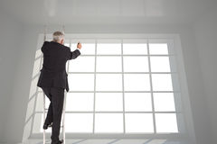 Mature businessman climbing career ladder Stock Photography