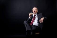 Mature businessman drinking coffee with milk Stock Photos