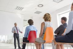 Mature businessman explaining strategy to colleagues at office during meeting stock photography