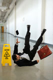 Mature Businessman Falling Stock Photography