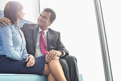 Mature businessman flirting with female colleague in office stock image