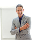 Mature businessman in front of a board Stock Photo