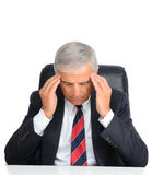 Mature Businessman with a headache Stock Photo