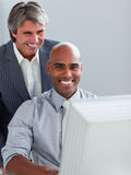 Mature businessman helping his colleague Stock Photography