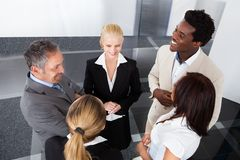 Mature businessman with his colleagues Stock Photo