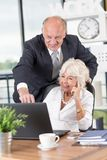 Mature businessman with his wife Royalty Free Stock Photography