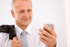 Mature businessman hold phone close-up portrait Stock Photography