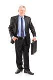 Mature businessman holding a briefcase Stock Photos