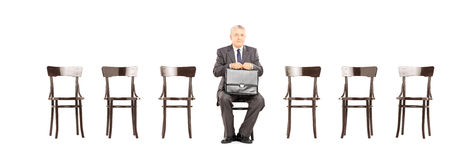 Mature businessman holding a briefcase and waiting for interview Royalty Free Stock Photography