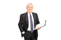 Mature businessman holding a clipboard Stock Photo