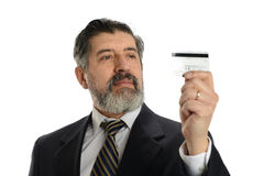Mature Businessman holding a credit card Royalty Free Stock Images