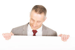 Mature businessman holding empty banner Stock Images