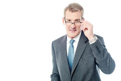 Mature businessman holding eye wear Royalty Free Stock Images