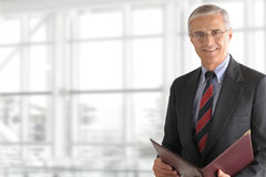 Mature Businessman Holding Folder Stock Photography