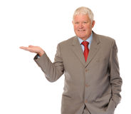 Mature businessman holding invisible product. Successful mature business man on white background, holding out hand (for product royalty free stock photography