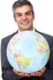 Mature businessman holding a terrestrial globe Royalty Free Stock Photography