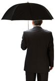Mature businessman holding an umbrella Royalty Free Stock Image