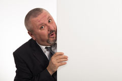 Mature businessman holding a white panel and gesturing isolated on white background Stock Photo