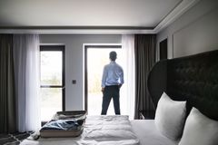 Mature businessman in a hotel room. Royalty Free Stock Photo
