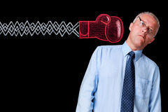 Mature businessman knockout punch Royalty Free Stock Photo