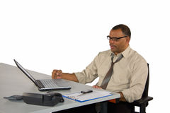 Mature businessman with laptop receiving good news Royalty Free Stock Photo