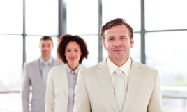 Mature businessman leading a team Stock Photo